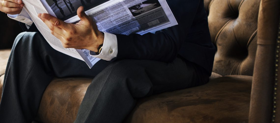 A businessman reading newspaper